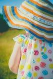 Fille dans un chapeau Photographie stock libre de droits