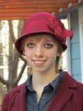Fille dans un chapeau rouge Photographie stock libre de droits