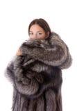 Fille dans un manteau de fourrure Photographie stock libre de droits