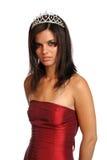 Fille dans une robe de soirée rouge et avec un diadème Photo libre de droits