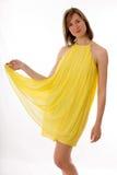 Fille dans une robe jaune Photographie stock libre de droits