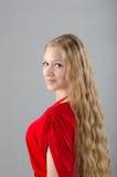Fille dans une robe rouge Image libre de droits