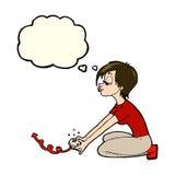fille de bande dessinée jouant des jeux d'ordinateur avec la bulle de pensée Images libres de droits