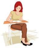 Fille de collégien dans l'écriture Image stock