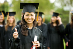 Fille de graduation Photo stock