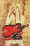 Fille de guitare de pays Photo libre de droits