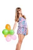 Fille de l'adolescence avec des ballons colorés Photos stock