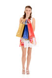 Fille de l'adolescence avec les sacs à provisions colorés Images libres de droits
