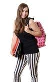 Fille de l'adolescence avec un sac à dos et des livres d'école Photo stock