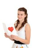 Fille de l'adolescence heureuse avec la carte de valentines Photos libres de droits