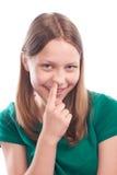 Fille de l'adolescence sélectionnant son nez Images stock
