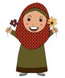 Fille de l'Islam avec la fleur Photographie stock libre de droits