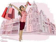 Fille de mode avec des paniers sur une ville-backgrou Images libres de droits