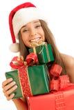 Fille de Noël avec des cadeaux photographie stock libre de droits