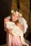 Fille de Noël avec la poupée Photos libres de droits