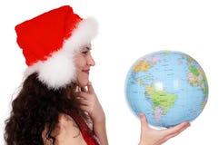 Fille de Noël avec le globe Photos libres de droits