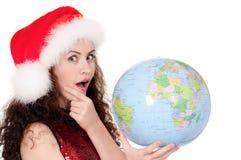 Fille de Noël avec le globe Photographie stock