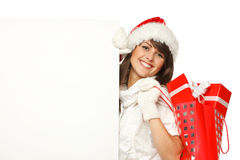 Fille de Noël avec le panneau-réclame Photographie stock