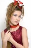 Fille de Noël dans la robe rouge Photographie stock