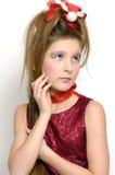 Fille de Noël dans la robe rouge Photographie stock libre de droits