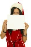 Fille de Noël retardant un signe blanc Images libres de droits