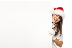 Fille de Noël tirant le panneau-réclame Photographie stock