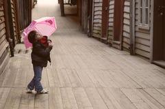 Fille de parapluie Image stock
