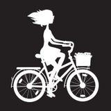 Fille de pochoir sur le vélo Photographie stock