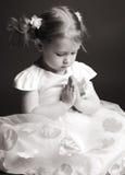 Fille de prière Photos stock