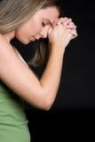 Fille de prière photo stock
