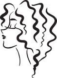 Fille de profil avec les cheveux onduleux Images stock