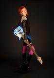 Fille de roche avec la guitare basse Image libre de droits
