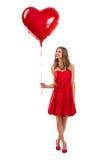 Fille de Saint-Valentin attirante avec le ballon Image stock