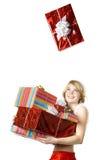 Fille de Santa avec des présents sur le fond blanc Images libres de droits