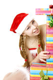 Fille de Santa avec des présents sur le fond blanc Photographie stock libre de droits