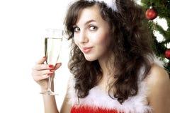 Fille de Santa avec une glace de champagne photos stock