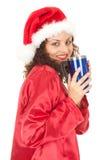 Fille de Santa dans le chapeau de Noël avec la grande cuvette bleue Image libre de droits