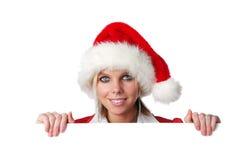 Fille de Santa retenant le signe blanc Image stock