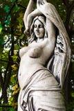 Fille de sculpture de pierre Photographie stock libre de droits