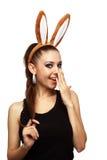 Fille de sourire avec des oreilles de lapin Images stock
