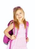 Fille de sourire avec le sac à dos au-dessus du blanc photo libre de droits