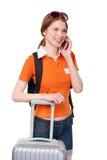 Fille de sourire avec le sac à dos et la valise Image stock