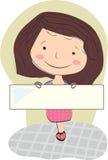 Fille de sourire avec les cheveux bruns tenant un blanc pour votre texte Photo stock