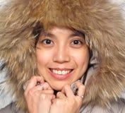 Fille de sourire d'Asiatique de l'hiver Photos libres de droits