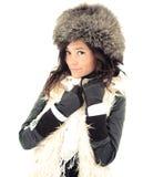 Fille de sourire dans le chapeau de l'hiver Photos libres de droits