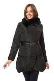 Fille dans un manteau duveteux noir Images stock