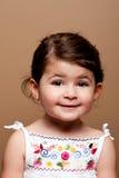 Fille de sourire heureuse d'enfant en bas âge Image stock
