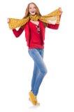 Fille de sourire mignonne dans la veste rouge et des jeans d'isolement Image stock