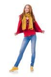 Fille de sourire mignonne dans la veste rouge et des jeans d'isolement Photos stock