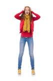 Fille de sourire mignonne dans la veste rouge et des jeans d'isolement Images stock